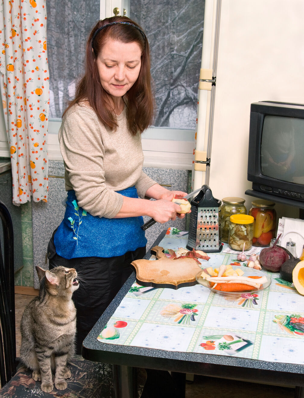 An owner may offer their pet extra food, for example during the preparation of human food.