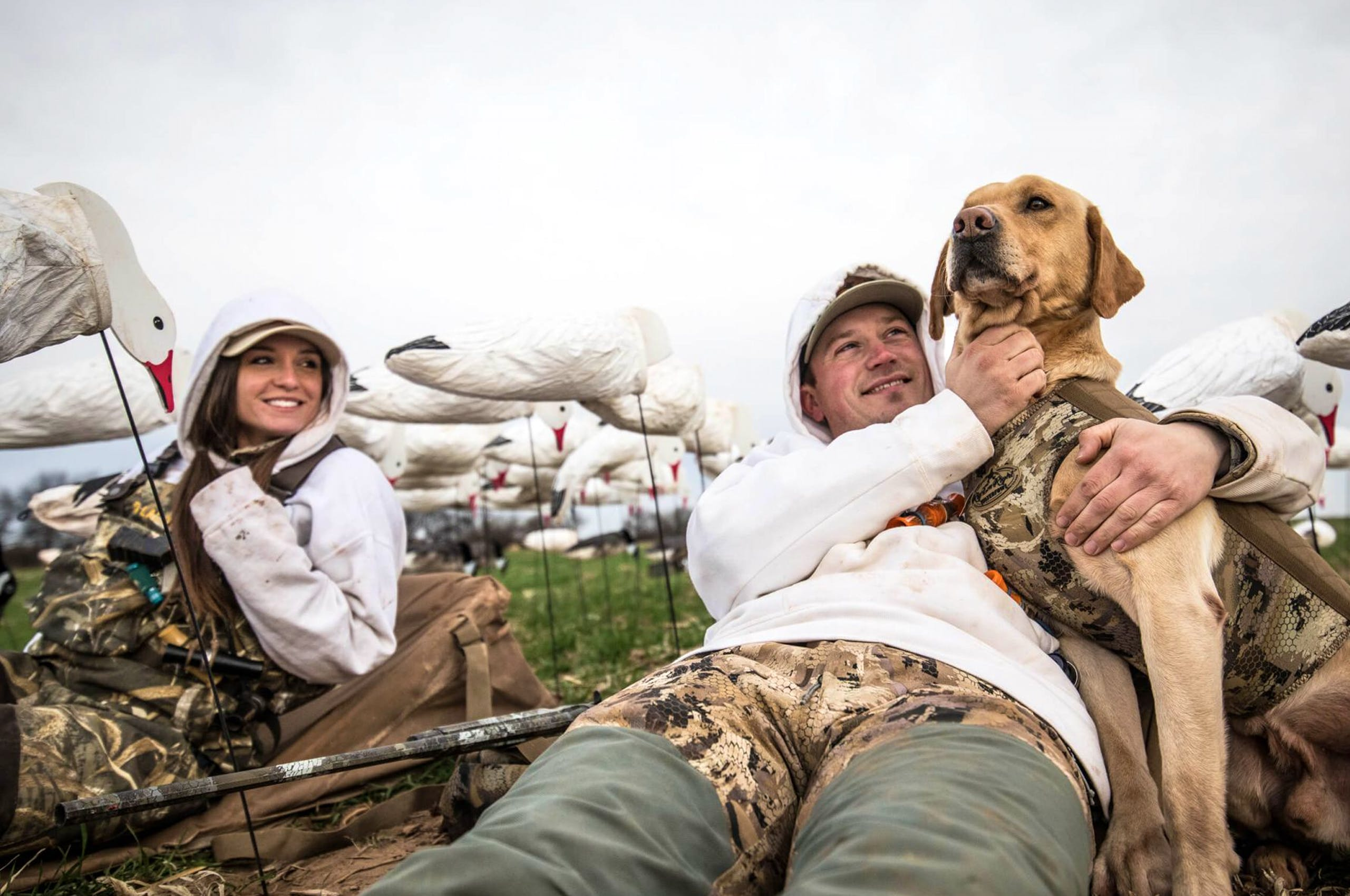 Man and Woman bonding with a British Lab in a layout blind