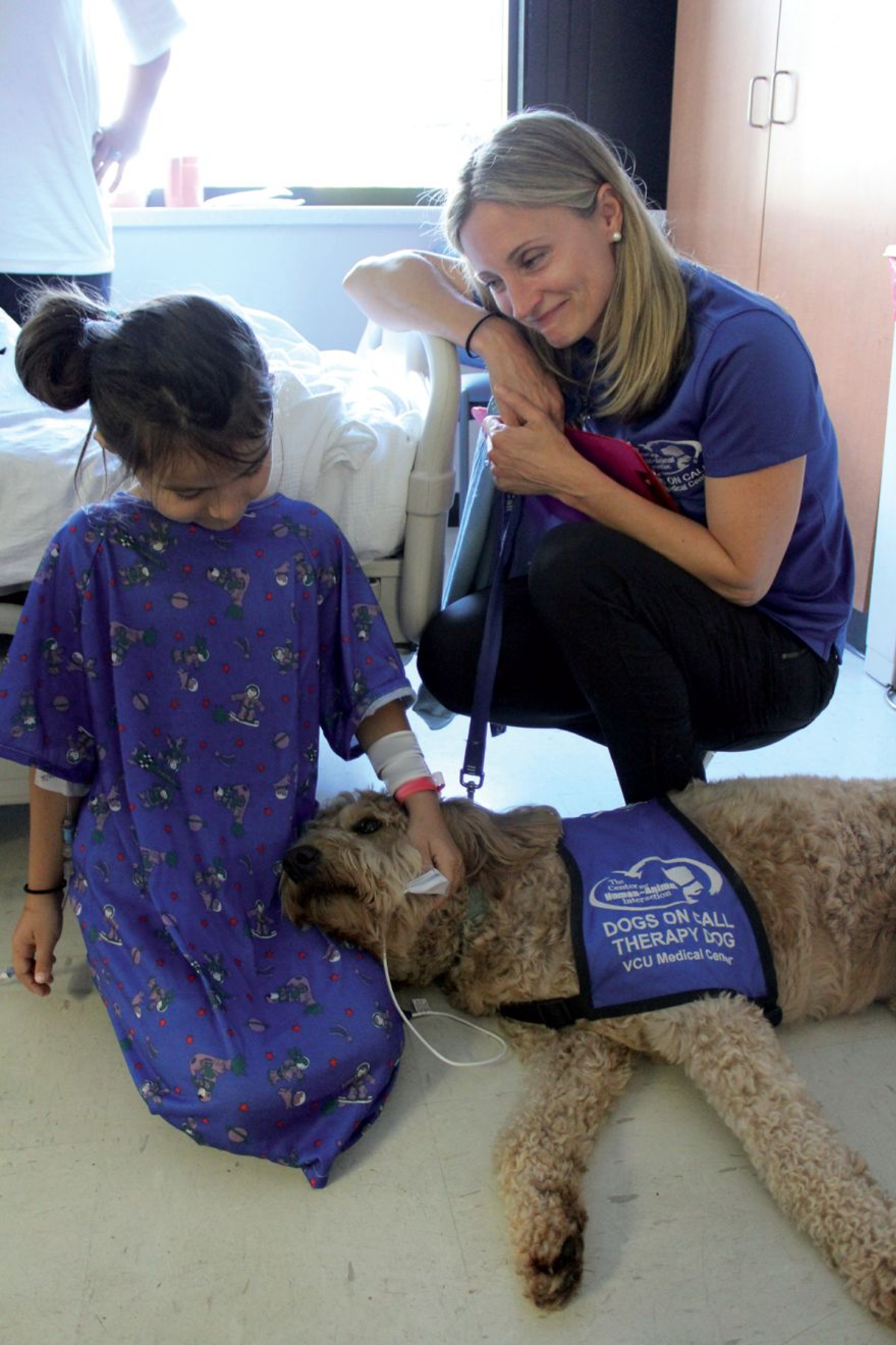 Figure 3. The VCU Dogs on Call (DoC) program has been very successful, with therapy dog teams routinely visiting most parts of the hospital. © Center for Human-Animal Interaction, School of Medicine, VCU